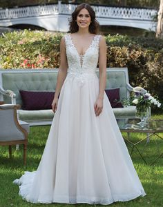 Sincerity wedding dress style 3941 This V-neck ball gown features beaded appliques, a basque waistline, low back and English Net skirt. A horsehair hem and a chapel length train complete this princess look.
