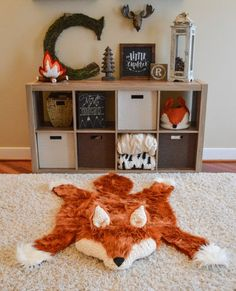 Add woodland charm to any room with this adorable handmade faux fox rug! This foxs body is crafted out faux luxury fur. size measures approximately 55 inches long x 45 inches wide. The foxs muzzle and ears are crocheted with a cream-colored yarn with a black felt nose. The fox rug is NOT attached to the cream colored rug in the listing photos. The cream colored rug is NOT included.  This precious rug is wonderful for baby showers, birthdays, and other gifting occasions.  This faux fox rug is…