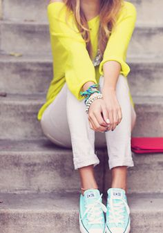Yellow top and skinny capris with light blue Converse and miscellaneous bracelets.