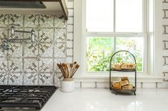 The patterned tile behind the oven was also hand painted and added a focal point to the kitchen.