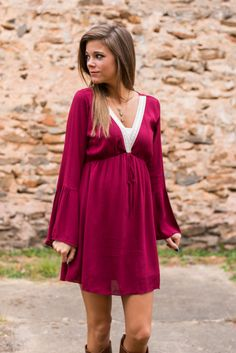 This bell-sleeved beauty is in the most gorgeous shade of burgundy we've seen all week! With dainty lace detailing the neckline and a fit too heavenly for words, this rich number is flawless for the season! It looks simply charming with a pair of brown boots!   Material has no amount of stretch. Elastic waistband with partial lining. You might want a cami handy with this one! :)  Miranda is wearing the small.