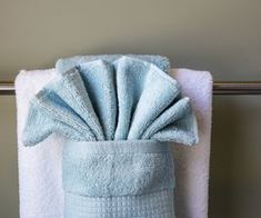 Some bath towels are quite expensive and you may purchase them only for display purposes. Hanging your bathroom towels decoratively is a great way to display them in your guest bathroom or any time you want to hang your plush towels in a fancy manner.