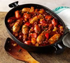 Sausage and Bean Casserole A comforting and hearty one-pot sausage stew with chorizo, smoked paprika and plenty of vegetables Sausage And Bean Casserole, Sausage Stew, Casserole Recipes, Veggie Sausage, Steak Casserole, Casserole Ideas, Chicken Sausage, Pork Recipes, Sausages