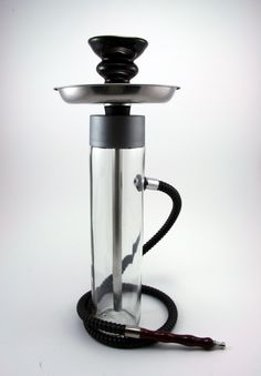 The Smoking Tower Hookah, shisha, glass bottle, ceramic, plastic, hose, bowl, water pipe. $39,99, via Etsy.
