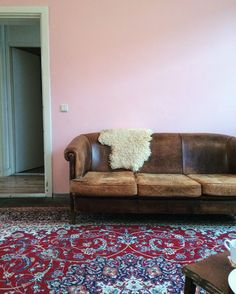 Living room pink wall sheep skin sheep leather couch Persian rug Arnhem