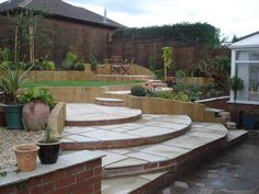 The finished garden from ground level, showing multiple level changes. Shame about the weather!