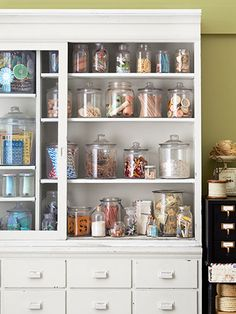 Crafting queen Cathe Holden uses an antique nine-foot-high apothecary cabinet to store her crafting supplies. But to curb chaos, Holden groups items together in an assortment of new and vintage glass jars. See more of Cathe's craft room makeover ideas. Sewing Room Design, Sewing Rooms, Craft Room Storage, Craft Organization, Storage Ideas, Organizing Crafts, Jar Storage, Small Storage, Storage Cabinets