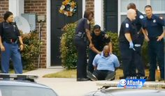 Jermiah Rutledge grieves the loss of his son in handcuffs after being tased by police. (Credit: CBS Atlanta video)