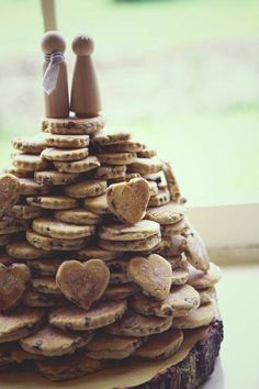 Cookie wedding tower-- a fun and inexpensive wedding cake alternative. Make up your own cookies and give guests the recipe for something really special.