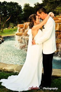 A kiss near the fountain of Avery Ranch
