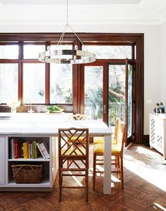 Kitchen with white island and door to balcony.
