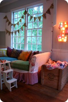 Totally diggin' the crazy slipcover on the sofa...heck, I like everything.