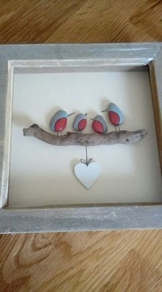 Red breasted stone birds on driftwood with hanging heart, framed rock art. Stone Crafts, Rock Crafts, Crafts To Do, Arts And Crafts, Sea Glass Crafts, Sea Glass Art, Art Pierre, Pebble Pictures, Driftwood Crafts