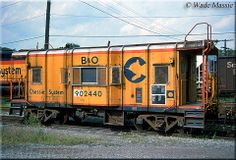 """Baltimore & Ohio """"Wagontop"""" caboose #902440 was pictured here at the Buffalo & Pittsburgh's Riker Yard in Punxsutawney, Pennsylvania on August 17, 1988."""