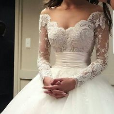Brides can get custom long sleeve wedding dresses like this created with any design preferences they need. You can also request us to make a #replica of your favorite haute couture wedding dress if the original is out of your price range. Get pricing and more details on custom long sleeve wedding dresses & replicas when you visit www.dariuscordell.com
