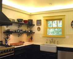 traditional kitchen by InsideOut Design, Inc: Shelves, wall, backsplash, sink, black & yellow combo.
