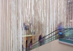 Strip Tease' by RAW A two-story installation of felt strips cascading from the atrium ceiling Home Design Decor, House Design, Home Decor, Id Photo, Atrium, Diy Kitchen, Hgtv, Factors, Blinds