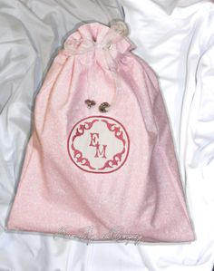Pink Drawstring Tote bag with Embroidered by Karen Faye and Company.  Pack up your stuff in our pink personalized draw string travel bags! Great tor shoes, lingerie, or toiletries. Protect your pretty shoes while traveling and keep your clothes fresh too. Fits a pair of heels even a pair of sneakers easily.   Embroidered Cotton fabric lined with flannel to protect your precious items.  Perfect for Bridesmaids gifts, Birthday and Mother's Day!