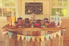 Pennant banner with contrasting fabrics. And great vintage inspired candy buffet!