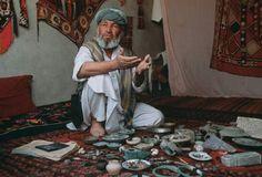 Near Ai Khanoum, in Kunduz province, northern Afghanistan, a merchant sells bracelets, a teapot, and an assortment of other artifacts. Photo by Kenneth Garrett