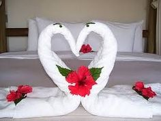 How to fold a Love Sign using one large and two small towels.