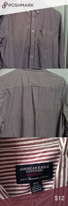 Mens American Eagle casual button down Color is white with a light maroon stripe design. Shirt has a pocket on the front with a dark grey logo. Condition is excellent. Light material and comfortable fit. American Eagle Outfitters Shirts Casual Button Down Shirts