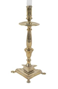 Late 17th Century Brass Candlestick On Paw Footed Base