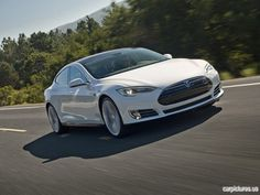 2012 Tesla Model S. just saw one of these and im in love!!!!