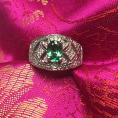 """14K Tsavorite Garnet Diamond Vintage Style Ring So pretty! Wide band ring is set with an oval bright, deep green Tsavorite Garnet. Stone is 7mm X 5mm. Garnets aren't always red! There are many tiny bead set diamonds throughout the setting (too many to count). Hallmarked """"14K"""" very hard to see. SIZE 5.75-6, and easily sized by your jeweler. Weighs 6.2 grams and is 11mm wide at widest front, band gradually  narrows to 3mm at very back. Excellent LIKE NEW condition!  Jewelry Rings"""