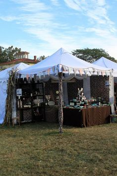 love the way the tent poles are decorated with fabric.also love that the tent is sectioned off so you can sit behind the tables Vendor Displays, Craft Booth Displays, Vendor Booth, Market Displays, Display Ideas, Craft Show Booths, Craft Show Ideas, Craft Font, Farmers Market Display