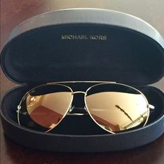 Michael Kors Kauai Aviators These are a limited edition Michael Kors pair of sunglasses. These are made of gold metal and have gold matallic lenses. Glasses are in mint condition Ans have only been worn a few times. Michael Kors Accessories Sunglasses