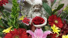 Concrete Angel with floral arrangement