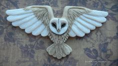 """MINE! MINE! MINE! (Yes, I am geek dancing now) LM announced a sale for today of some of her pieces and I am grateful to have one of her owls. Porcelain Cabochon """"Flying Barn Owl"""" by Laura Mears"""