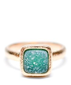 I love rings with natural stones.  I would want this in silver with teal, green, and purple stones.
