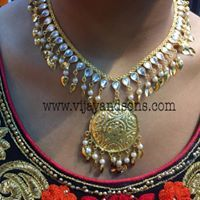 Beautiful Peeplepati necklace platted on Gold  Buy online #Peeplepati #Kundan necklace by #Vijay and sons. You can order online by clicking Vijay and Sons link given below. #Fresh and #Evergreen high quality metal used for designing this necklace. You must look #gorgeous and adorable by wearing this necklace with any Traditional outfit. For more quries please contact us: Phone No.: 9888848871 Choker Necklace Online, Pearl Necklace, Jhumar, Traditional Outfits, Evergreen, Wedding Jewelry, Sons, Chokers, Bangles