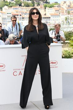 Monica Bellucci teamed her Stella McCartney jumpsuit with sunglasses at the Mistress of Ceremonies Photocall at the Cannes Film Festival - May 17 2017