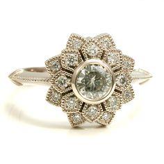 Moissanite and Diamond Art Deco Petal Engagement Ring - 14k Palladium White Gold by SwankMetalsmithing on Etsy https://www.etsy.com/listing/181518592/moissanite-and-diamond-art-deco-petal