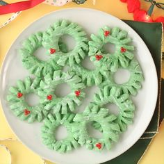 These super easy Christmas cookies don't need fancy decoration to look stunning. Instead of decorating these Christmas sugar cookies with piped frosting, give cookies more dimension by shaping and snipping the cookie dough to give a decorated look no piping bag required. #christmascookies #easychristmascookies #decoratedchristmascookies #cutecookierecipes #bhg