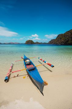 A boat is docked on the beach of Atwayan, one of countless islands comprising the town of Coron in Palawan, Philippines.