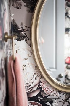 pink floral wallpaper with gold mirror  brunette story home reveal