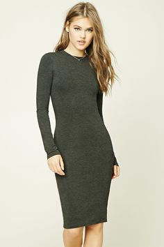 A heather knit dress featuring a bodycon silhouette, a round neckline, long sleeves and a double layer.