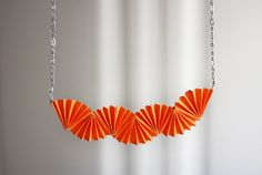 Necklaces Diy Origami Necklace - Teenagers and tweens will love this origami style necklace they can make using simple pleats and a few jewelry supplies. Origami Necklace, Origami Jewelry, Paper Jewelry, Diy Necklace, Fashion Necklace, Jewelry Crafts, Handmade Jewelry, Necklaces, Orange Necklace