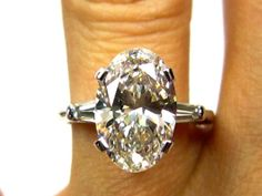 Estate Vintag 3.24ct Classic OVAL Cut Diamond EGL USA Engagement Ring in Platinum with Baguettes, Circa 1960