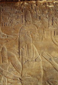 Anubis holding the mummy relief from the tomb of Maia wetnurse of Tutankhamun Saqqara Egypt