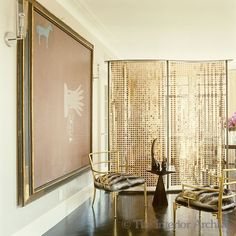 Billy Haines gilt chairs upholstered in  chinchilla and a vintage Paco Rabanne screen. Chinchilla no less!:
