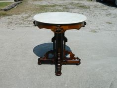 The apron features carved fruit. A center pedestal leads down to a cross shaped stretcher base holding lovely carved scrolling. This is a great table sure to make lasting impression on all who see it.   eBay!