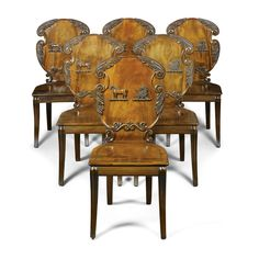 A SET OF SIX WILLIAM IV CARVED MAHOGANY HALL CHAIRS CIRCA 1832, BY ROBERT LAWSON AND ROBERT FARMER OF GILLOWS, LANCASTER each bearing the crest of the Cole family, the underside of one seat with the journeyman's pencil inscription `Lawrence', two chairs stamped `GILLOWS LANCASTER'