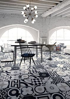 Black & white & patterned, this modern dining room has so much going for it. Mismatched tiles, white brick walls, & a starburst chandelier give this space an urban feel. Floor Design, Tile Design, Bathroom Floor Tiles, Tile Floor, Kitchen Floor, Interior Architecture, Interior And Exterior, Interior Decorating, Interior Design