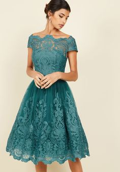 <p>Make an unforgettable entrance in this decadently embroidered dress by Chi Chi London! With an ornate illusion neckline, intricate scalloped lace, and a full, tulle-lined skirt, this teal frock exudes timeless feminine flair.</p>