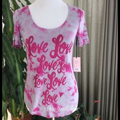 """Juicy Couture """"Love"""" Top NWT  Pink and gray tie dye with """"love in pink glitter  Scoop neckline & rounded hemline. Nice weight jersey fabric that drapes well. 95% rayon; 5% spandex  Bust 33"""" stretches to about 35""""; length 23 - about 26"""" at longest part   NWT. Smoke free home  Juicy Couture Tops Tees - Short Sleeve"""
